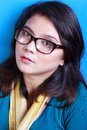 Hot geek nerdy beautiful woman in blue background Stock Photography
