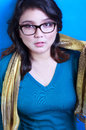 Hot geek nerdy beautiful woman in blue background Royalty Free Stock Images