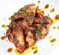 Hot grilled chicken wings on white plate Royalty Free Stock Photo