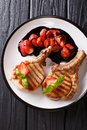 Hot grilled tasty pork chop with balsamic strawberry close-up on Royalty Free Stock Photo