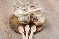Hot ice cream with plums in dessert glasses wooden spoons Royalty Free Stock Images