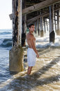 Hot male model at newport beach california standing near the pier Stock Photo