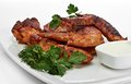 Hot meat dishes grilled chicken wings with red spicy sauce Stock Images