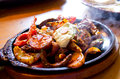 Hot mexican diner meat with vegetables Stock Image