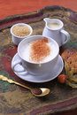 Hot milk with nutmeg cup of and brown sugar Royalty Free Stock Photo