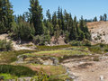 Hot mineral pool in mountain valley water creates a colorful pond the active volcanic at lassen volcanic national park california Royalty Free Stock Photo
