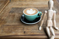 Hot mocha coffee or capuchino in the green cup on the wooden table