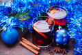 Hot mulled wine with spices and blue garland Royalty Free Stock Photo