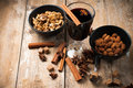 Hot mulled wine spices and nuts a glass of cinnamon star anise brown sugar on a wooden board Stock Photos