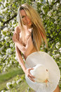 Hot natural blond over blossom trees Royalty Free Stock Photo
