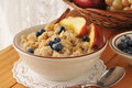 Hot oatmeal cereal a bowl of with brown sugar cinnamon sticks and blueberries Stock Image