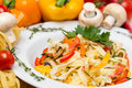 Hot pasta with garnish on plate white Stock Photography