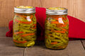 Hot pepper slices canned in mason jars pickled and Royalty Free Stock Photos