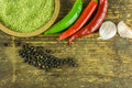 Hot peppers of different colors, black pepper and garlic Royalty Free Stock Photo
