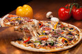 Hot pizza a slice of on the wooden table Stock Image