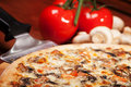 Hot pizza on the wooden table Royalty Free Stock Photography