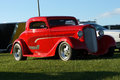 Hot rod napierville dragway august front side view of classic red during car show at john scotti all out event Royalty Free Stock Photos