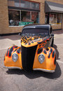 Hot rod yellow red flames being displayed at an outdoor car show Royalty Free Stock Images