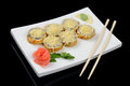 Hot rolls with cheese six and chopsticks Royalty Free Stock Photo