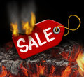 Hot sale and liquidation savings concept with a red price tag on fire over burning coals as a consumer symbol of marketing and Stock Photo