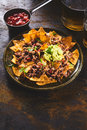 Hot sauce with chips, guacamole and beer Royalty Free Stock Photo