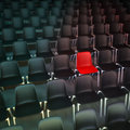 Hot seat d rendering of rows of black chairs and a red one Royalty Free Stock Photography