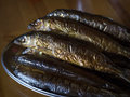 Hot smoked Omul (endemic species of fish in the lake Baikal, Russia). Royalty Free Stock Photo
