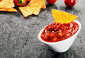Hot spicy salsa sauce with corn tortillas serving of made tomato and chili peppers in a bowl or nachos to dip for a savory Stock Photography