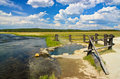 Hot spring by the river, Yellowstone, Wyoming Royalty Free Stock Photo
