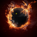 Hot squash ball in fires flame Royalty Free Stock Image