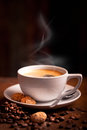 Hot steaming coffee cup of on dark background Royalty Free Stock Photo