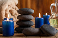 Hot stones essential oil and candles dark tone Stock Photography