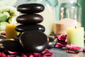 Hot stones essential oil and candles selective focus Royalty Free Stock Image