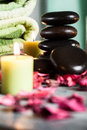 Hot stones essential oil and candles selective focus Royalty Free Stock Images