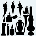 Hot stuff: candle, flaming torches, kerosene lamp and metal zippo lighter Royalty Free Stock Photo