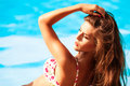 Hot summer woman in bikini on pool day Royalty Free Stock Image