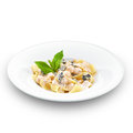 Hot tasty pappardelle with sweet pear and walnuts italian decorated basil leaf on white Stock Image
