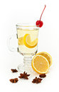 Hot tea glass cup with lemon decorated with a cherry on a white background Royalty Free Stock Photos