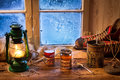 Hot tea in a small house at winter day Stock Photos