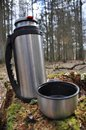 Hot tea in thermos for a walk in the woods Royalty Free Stock Photo