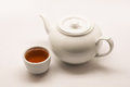 Hot tea in white teacup and white hot pot Royalty Free Stock Photo