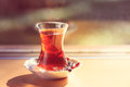 Hot turkish tea outdoors near glass wall. Turkish tea and tradit Royalty Free Stock Photo