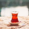 Hot turkish tea outdoors near water. Turkish tea and traditional Royalty Free Stock Photo