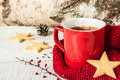 Hot winter tea in a red mug with christmas cookies star shaped and warm scarf and white rural still life Royalty Free Stock Photography