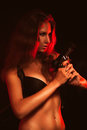 Hot woman in black bra and gun studio Royalty Free Stock Image