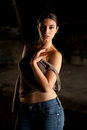 Hot woman with blue jeans and brown top Royalty Free Stock Photography