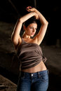 Hot woman with blue jeans and brown top Stock Images