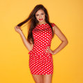 Hot woman wearing red polka dots dress with black stiletto Royalty Free Stock Photo