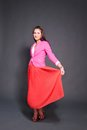 Hot young brunette in red skirt and pink jacket Stock Images
