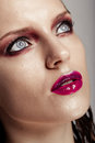 Hot young woman model with sexy bright red lips makeup strong eyebrows clean shiny skin and wet hairstyle beautiful fashion Royalty Free Stock Photography